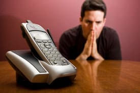 hopeful-man-waiting-by-phone